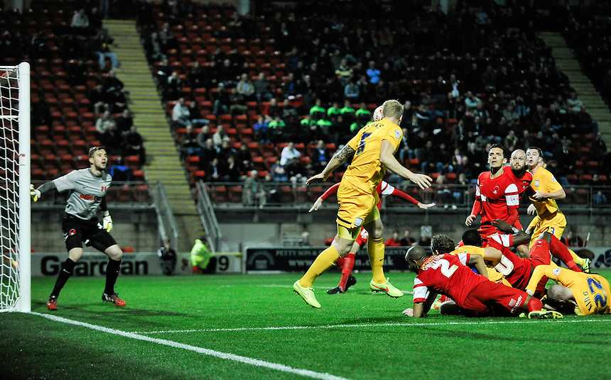 Preston North End's Tom Clarke heads the ball back for Paul Huntington to score<br /> <br /> Photographer Ashley Western/CameraSport<br /> <br /> Football - The Football League Sky Bet League One - Leyton Orient v Preston North End - Tuesday 28th October 2014 - Matchroom Stadium - London<br /> <br /> &copy; CameraSport - 43 Linden Ave. Countesthorpe. Leicester. England. LE8 5PG - Tel: +44 (0) 116 277 4147 - admin@camerasport.com - www.camerasport.com