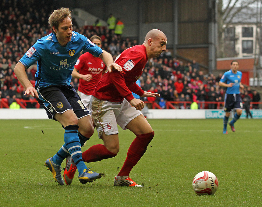 Nottingham Forest's Alan Hutton shields the ball from Leeds United's Luciano Becchio...Football - npower Football League Championship - Nottingham Forest v Leeds United - Wed 26 Dec 2012 - City Ground - Nottingham......