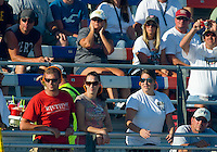 Sept. 19, 2010; Concord, NC, USA; NHRA fans wear ear plugs as they watch action during the O'Reilly Auto Parts NHRA Nationals at zMax Dragway. Mandatory Credit: Mark J. Rebilas-