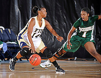 11 November 2011:  FIU's Kamika Idom (14) handles the ball while being defended by Jacksonville's Abril Peeples (1) in the first half as the FIU Golden Panthers defeated the Jacksonville University Dolphins, 63-37, at the U.S. Century Bank Arena in Miami, Florida.