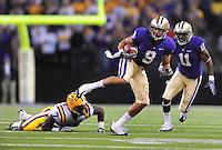 Sept. 5, 2009; Seattle, WA, USA; Washington Huskies wide receiver (9) Devin Aguilar runs the ball against the LSU Tigers at Husky Stadium. Mandatory Credit: Mark J. Rebilas-
