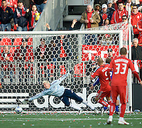26 April 2009:  Toronto FC forward Danny Dichio #9 scores the only goal on Kansas City Wizards goalkeeper Kevin Hartman #1 during an MLS game at BMO Field between Kansas City Wizards and Toronto FC.Toronto FC won 1-0. .
