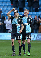Jason McCarthy of Wycombe Wanderers with goalscorer Luke O'Nien (left) of Wycombe Wanderers during the Sky Bet League 2 match between Wycombe Wanderers and Bristol Rovers at Adams Park, High Wycombe, England on 27 February 2016. Photo by Andrew Rowland.