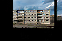 A devastated apartment block seen through an empty window in the Gipsy ghetto of Chanov on outskirts of Most, Czech Republic, 22 March 2008.