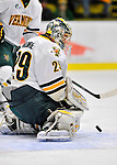 22 November 2011: University of Vermont Catamount goaltender Rob Madore, a Senior from Pittsburgh, PA, makes a first period save against the University of Massachusetts Minutemen at Gutterson Fieldhouse in Burlington, Vermont. The Catamounts defeated the Minutemen 2-1 in their annual pre-Thanksgiving meeting in the Hockey East season. Mandatory Credit: Ed Wolfstein Photo