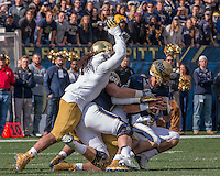 The Notre Dame defense sacks Pitt quarterback Nate Peterman. The Notre Dame Fighting Irish football team defeated the Pitt Panthers 42-30 on Saturday, November 7, 2015 at Heinz Field, Pittsburgh, Pennsylvania.