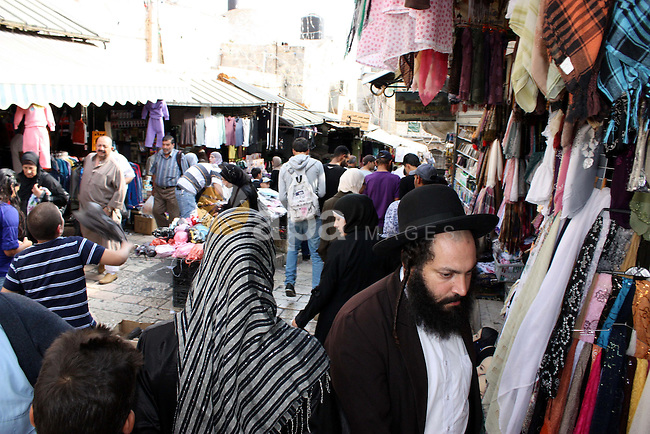 Palestinians shop at a market in the old city of Jerusalem on November 15, 2010, ahead of the Muslim holiday of Eid al-Adha or Feast of the Sacrifice, which marks the end of the annual hajj or pilgrimage to Mecca and is celebrated in remembrance of Abraham's readiness to sacrifice his son to God. Photo by Mohammed Alfateh