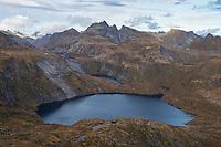 Stuvdalsvatnet lake surrounded by autumn mountain landscape, Moskenesøy, Lofoten Islands, Norway