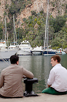 International University of Monaco students Salvatore (left) and Felix (right) spend time on the quayside in the Port of Fontvielle, Fontvielle, Monaco, 19 April 2013
