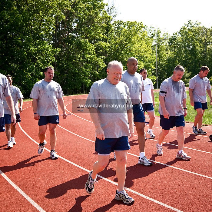 Police officers from around the country and abroad exercise on a track at the FBI National Academy in Quantico, VA, USA, 12 May 2009.