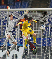 Calcio, Champions League: Gruppo E - Roma vs Bate Borisov. Roma, stadio Olimpico, 9 dicembre 2015.<br /> From left, Roma's goalkeeper Wojciech Szczesny, defender Antonio Ruediger and Bate Borisov's Mikhail Gordeichuk fight for the ball during the Champions League Group E football match between Roma and Bate Borisov at Rome's Olympic stadium, 9 December 2015.<br /> UPDATE IMAGES PRESS/Riccardo De Luca