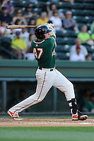 Catcher Chad Wallach (47) of the Greensboro Grasshoppers bats in a game against the Greenville Drive on Wednesday, May 7, 2014, at Fluor Field at the West End in Greenville, South Carolina. Greenville won, 12-8. (Tom Priddy/Four Seam Images)