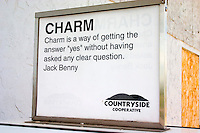 Jack Benny quote about charm on a sign.  Wisconsin