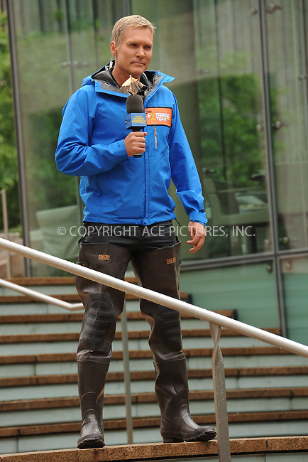 WWW.ACEPIXS.COM . . . . . .May 15, 2012...New York City....Sam Champion does the weather report from Lincoln Center on May 15, 2012  in New York City ....Please byline: KRISTIN CALLAHAN - ACEPIXS.COM.. . . . . . ..Ace Pictures, Inc: ..tel: (212) 243 8787 or (646) 769 0430..e-mail: info@acepixs.com..web: http://www.acepixs.com .