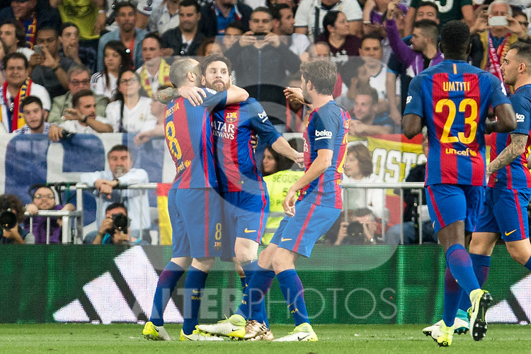 Leo Messi, Andres Iniesta and Jordi Alba of FC Barcelona celebrates after scoring a goal during the match of La Liga between Real Madrid and Futbol Club Barcelona at Santiago Bernabeu Stadium  in Madrid, Spain. April 23, 2017. (ALTERPHOTOS)