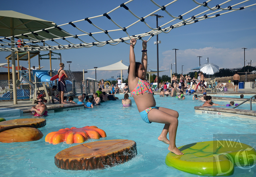 NWA Democrat-Gazette/BEN GOFF @NWABENGOFF<br /> Anita Gonzalez, 9, of Rogers negotiates her way across floating pads on Sunday Sept. 6, 2015 at the Rogers Aquatic Center. The water park will be open for the last day of the 2015 season on Monday from 11:00a.m. to 7:00p.m.
