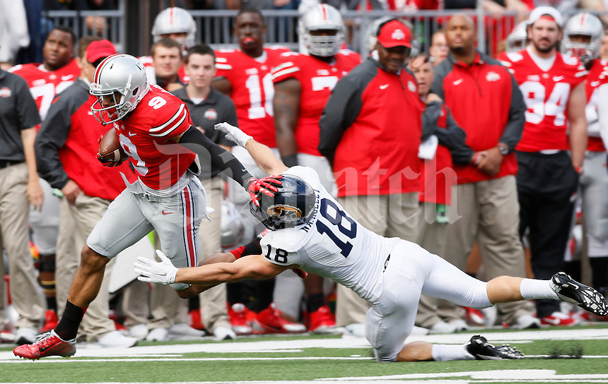 Ohio State Buckeyes wide receiver Devin Smith (9) slips away from Kent State Golden Flashes safety Nate Holley (18) on his way to scoring a touchdown during Saturday's NCAA Division I football game at Ohio Stadium in Columbus on September 13, 2014. Ohio State won the game 66-0. (Dispatch Photo by Barbara J. Perenic)