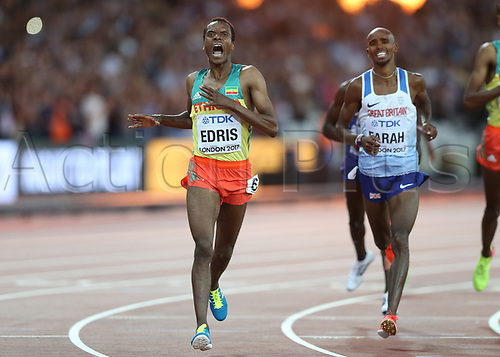 August 12th 2017, London Stadium, East London, England; IAAF World Championships, Day 9; Muktar Edris of Ethiopia celebrates scoring the finishing line in 1st place to become World Champion of the 5000 metres men final with Mo Farah of Great Britain looking on in disappear as he finishes in 2nd place