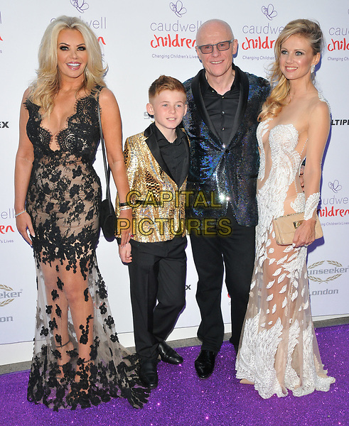 Claire Johnson, young guest, John Caudwell and Modesta Vzesniauskaite at the Caudwell Children Butterfly Ball, Grosvenor House Hotel, Park Lane, London, England, UK, on Thursday 25 May 2017.<br /> CAP/CAN<br /> &copy;CAN/Capital Pictures