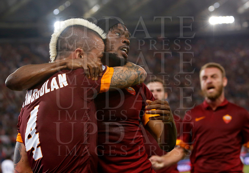 Calcio, Serie A: Roma vs Fiorentina. Roma, stadio Olimpico, 30 agosto 2014.<br /> Roma midfielder Radja Nainggolan, of Belgium, left, is hugged by teammate Gervinho, of Ivory Coast, after scoring during the Italian Serie A football match between AS Roma and Fiorentina at Rome's Olympic stadium, 30 August 2014.<br /> UPDATE IMAGES PRESS/Riccardo De Luca