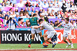 #12 Alex Davis of England (C) tries to tackle #1 Heino Bezuidenhout of South Africa (L) during the HSBC Hong Kong Sevens 2018 match between South Africa and England on April 7, 2018 in Hong Kong, Hong Kong. Photo by Marcio Rodrigo Machado / Power Sport Images