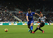 9th December 2017, St James Park, Newcastle upon Tyne, England; EPL Premier League football, Newcastle United versus Leicester City; Dwight Gayle of Newcastle United shoots past Harry Maguire of Leicester City in the second half