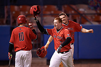 Ball State Cardinals first baseman Caleb Stayton (34) celebrates with Sean Kennedy (10) and Jarett Rindfleisch (25) after hitting a home run during a game against the Wisconsin-Milwaukee Panthers on February 26, 2016 at Chain of Lakes Stadium in Winter Haven, Florida.  Ball State defeated Wisconsin-Milwaukee 11-5.  (Mike Janes/Four Seam Images)
