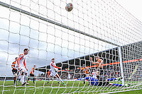Cameron McGeehan of Luton Town (centre) scores his team's first goal against Barnet to make it 1-1 during the Sky Bet League 2 match between Barnet and Luton Town at The Hive, London, England on 28 March 2016. Photo by David Horn.