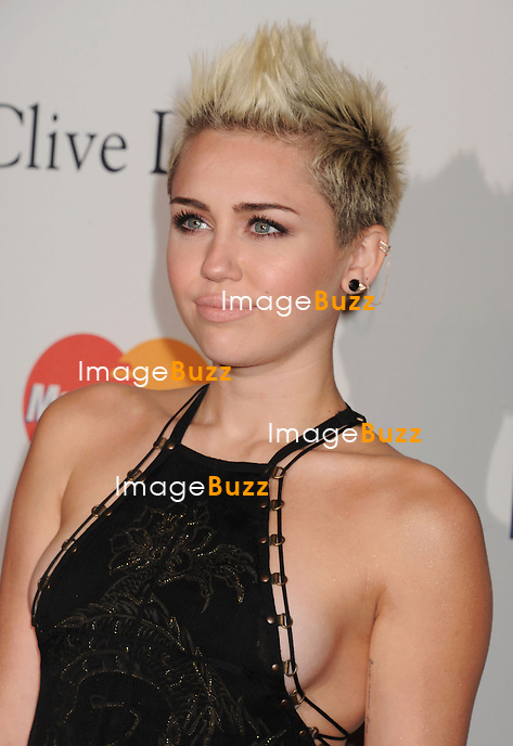 BEVERLY HILLS, CA - FEBRUARY 09: Miley Cyrus arrives at the The 55th Annual GRAMMY Awards - Pre-GRAMMY Gala And Salute To Industry Icons Honoring L.A. Reid at the Beverly Hilton Hotel on February 9, 2013 in Beverly Hills, California.