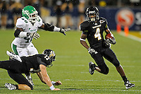 1 September 2011:  FIU wide receiver T.Y. Hilton (4), with a block from quarterback Wesley Carroll (13), evades North Texas defensive end K.C. Obi (48) in the first half as the FIU Golden Panthers defeated the University of North Texas, 41-16, at University Park Stadium in Miami, Florida.