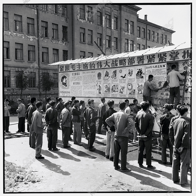 "Red Guards hang big character posters at Harbin's University of Industry. The billboard reads, ""Follow Chairman Mao's great strategy and grasp the direction of revolutionary struggle."" Harbin, 4 September 1967"