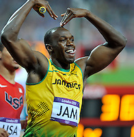Usain Bolt (JAM) running the last leg of the 4x100m relay does a 'Mo' as he celebrates Jamaica's win..Olympic Stadium.Olympic Park.Olympics 2012.London UK. .11/08/12,.photo: Sean Ryan / IPS Photo Agency.. mobile: 07971 400 939.Address: Thatched Cottage,Wretham,Thetford, Norfolk IP24 1RH .Office tel: 01953 499 403...