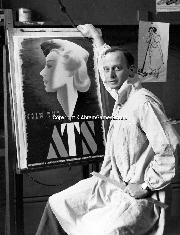 BNPS.co.uk (01202 558833)<br /> Pic: AbramGamesEstate<br /> <br /> Abram Games with his controversial poster.<br /> <br /> Rare survivor - WW2 'Blonde Bombshell' poster that was banned for being to glamorous emerges.<br /> <br /> A rare copy of a controversial wartime poster for the women's ATS that had to be pulped following complaints by a feminist MP has come to light.<br /> <br /> The poster aimed at getting women to join the Auxiliary Territorial Army was produced in 1941 by renowned graphic designer Abraham Games.<br /> <br /> He deliberately glamourised the service by turning brunette model Doreen Murphy into a blonde, giving her red lipstick and putting her cap at a 'sexy' angle.<br /> <br /> Games' aim was to appeal to younger women but his 'blonde bombshell' poster drew complaints.<br /> <br /> Some 10,000 copies were destroyed but one that has survived has emerged for sale in Dorset for £5,000.