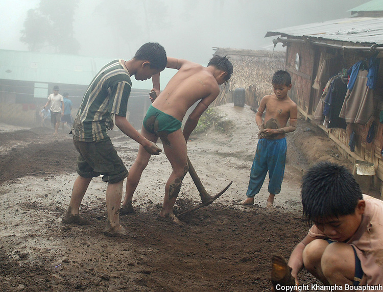 Shan orphans work at their village in Doi Talang, Burma on June 18, 2005.  (photo by Khampha Bouaphanh)