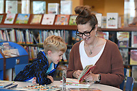 NWA Democrat-Gazette/J.T. WAMPLER Emily Brannon of Rogers reads to her son James, 5, Monday May 13, 2019 at the Fayetteville Public Library. Children are encouraged to sign up for the Summer Reading Program and read books for prizes this summer. On June 1st there will be a kickoff event at the library. For more information visit www.faylib.org