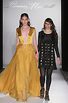 Fashion designer Leanne Marshall walks runway with model at the close of her Leanne Marshall Fall Winter 2016 fashion show, at Fashion Gallery New York Fashion Week, during New York Fashion Week Fall 2016.