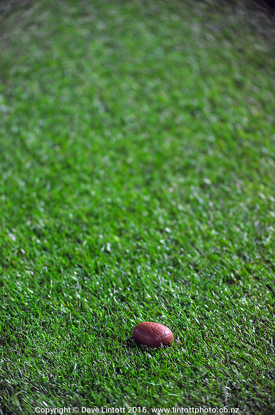 An easter egg sits in the grass during the Super Rugby match between the Hurricanes and Southern Kings at Westpac Stadium, Wellington, New Zealand on Friday, 25 March 2016. Photo: Dave Lintott / lintottphoto.co.nz
