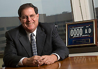 Bill Webster, Director of GSA Fleet, in his office in Arlington, VA with the first GSA Fleet license tag. August 1, 2007. (James J. Lee / Federal Times).