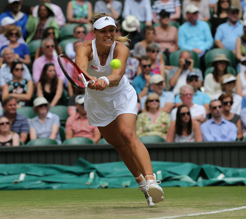 Angelique Kerber (GER) [9] in action playing against Maria Sharapova (RUS) [5] in their Ladies' Singles Fourth Round match today<br /> <br /> Photographer Kieran Galvin/CameraSport<br /> <br /> Tennis - Wimbledon Lawn Tennis Championships - Day 8 Tuesday 1st July 2014 -  All England Lawn Tennis and Croquet Club - Wimbledon - London - England<br /> <br /> &copy; CameraSport - 43 Linden Ave. Countesthorpe. Leicester. England. LE8 5PG - Tel: +44 (0) 116 277 4147 - admin@camerasport.com - www.camerasport.com.