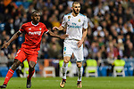 Karim Benzema of Real Madrid (R) fights for position with Lionel Carole of Sevilla FC (L) during La Liga 2017-18 match between Real Madrid and Sevilla FC at Santiago Bernabeu Stadium on 09 December 2017 in Madrid, Spain. Photo by Diego Souto / Power Sport Images