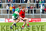 Man of the Match Pa Kilkenny Glenbeigh/Glencar goes past Ian McCarthy Na Gaeil during the Junior Premier final in Fitzgerald Stadium on Sunday
