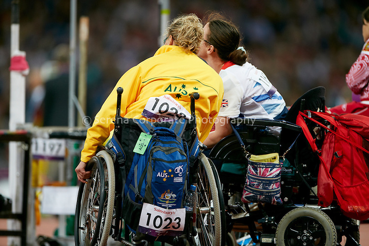 Louise Ellery (AUS) and Gemma Prescott (GBR) share a moment during competition in the women's F32/33/34 shotput at the London Paralympic Games - Athletics 6.9.12