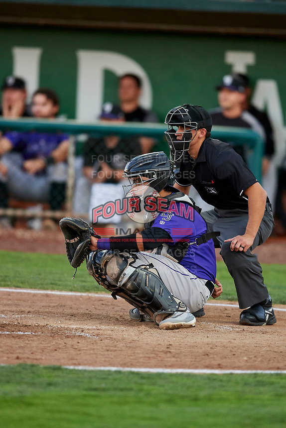 Javier Guevara (6) of the Grand Junction Rockies on defense in front of umpire John Perez during a game against the Ogden Raptors at Lindquist Field on September 7, 2018 in Ogden, Utah. The Rockies defeated the Raptors 8-5. (Stephen Smith/Four Seam Images)