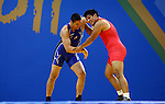 GUADALAJARA, MEXICO - OCTOBER 21:  Panaglotys Gounaridis of the USA and Joel Lopez of Mexico grapple in the Men's Greco-Roman Semifinal Bout during Day Six of the XVI Pan American Games at the Code II Sports Complex on October 21, 2011 in Guadalajara, Mexico.  (Photo by Donald Miralle for Mexsport) *** Local Caption ***