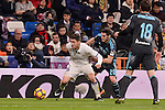 Real Madrid's Mateo Kovacic and Real Sociedad's Joseba Zaldua during La Liga match between Real Madrid and Real Sociedad at Santiago Bernabeu Stadium in Madrid, Spain. January 29, 2017. (ALTERPHOTOS/BorjaB.Hojas)