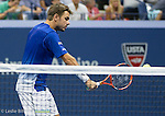Stanislas Wawrinka (SUI) falls behind Roger Federer (SUI) in the first set,  6-4 at the US Open in Flushing, NY on September 11, 2015.
