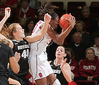 STANFORD, CA - February 23, 2012:  Nnemkadi Ogwumike pulls down a rebound during Stanford's 68-46 victory over Colorado in Stanford, California on February 23,  2012.