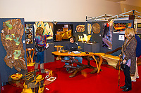 Aaron Laux displays carved wood furniture of Aaron Laux Design at The Winter Art Fair off the Square at Monona Terrace Community and Convention Center on Sunday, November 15, 2015 in Madison, Wisconsin