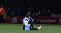 Michael Harriman of Wycombe Wanderers sits injured during the Sky Bet League 2 match between Wycombe Wanderers and Portsmouth at Adams Park, High Wycombe, England on 28 November 2015. Photo by Andy Rowland.
