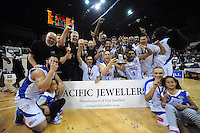 The Saints celebrate winning the national basketball league final between Wellington Saints and Bay Hawks at TSB Bank Arena, Wellington, New Zealand on Saturday, 5 July 2014. Photo: Dave Lintott / lintottphoto.co.nz